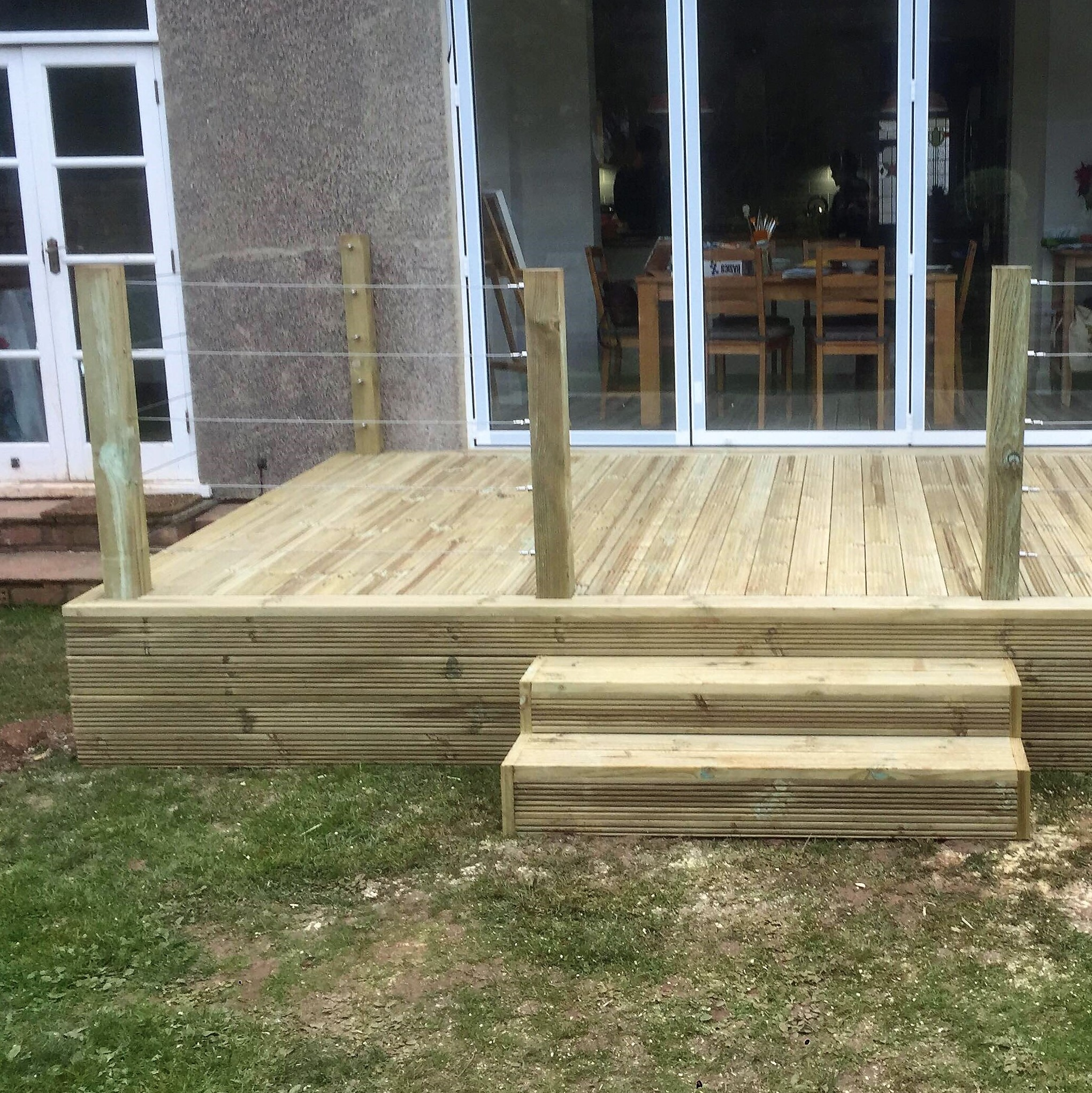 Deck building with metal wire balustrades